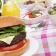 Al Fresco Dining With Hamburgers And Salad - Stock Photo