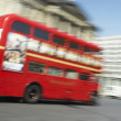 Stock Photo: Double Decker Bus Driving Through Streets Of London