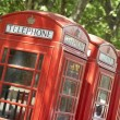 Red Telephone Booths In A Row - Stock Photo