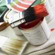 Stack Of Paint Brushes, Paint Tins And Color Wheels — Stock Photo