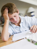 Young Boy Doing Homework In His Room — Stock Photo