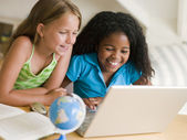 Two Young Girls Doing Their Homework On A Laptop — Stock Photo