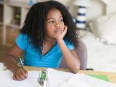 Young Girl Doing Homework — ストック写真