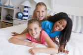 Three Young Friends Lying On Top Of Each Other — Stock Photo