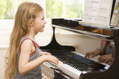 Young Girl Playing Piano — Stok fotoğraf
