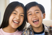 Brother And Sister Laughing — Stock Photo
