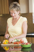 Woman Cutting Up Vegetables — Stock Photo