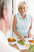 Woman Talking To Husband As She Prepares A meal,mealtime — Stock Photo