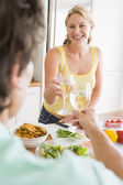 Woman Talking To Husband While Preparing meal,mealtime — Stock Photo
