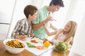 Father And Children Prepare A meal,mealtime Together — Stock Photo