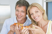 Husband And Wife Eating Pizza — Stock Photo