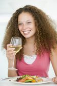 Woman Eating meal,mealtime With A Glass Of Wine — Stock Photo