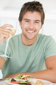 Young Man Enjoying meal,mealtime With A Glass Of Wine — Stock Photo
