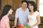 Family Laughing While Preparing meal,mealtime — Stock Photo