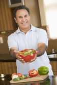 Man Presenting Salad — Stock Photo