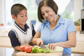 Grandmother And Grandson Preparing meal,mealtime Together — Stock Photo