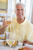 Man Enjoying meal,mealtime With A Glass Of Wine — Stock Photo