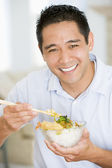 Man Enjoying Chinese Food With Chopsticks — Stock Photo