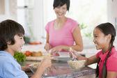 Children Enjoying Breakfast While Mother Is Preparing Food — Stock Photo