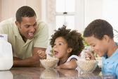 Children Eating Breakfast With Dad — Stock Photo