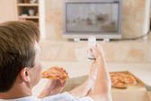 Man Enjoying Pizza While Watching TV — Stock Photo