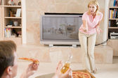 Wife Telling Husband Off For Drinking Beer And Eating Pizza — Stock Photo