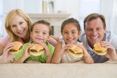 Family Eating Cheeseburgers Together — Stock Photo