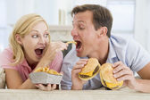 Couple Enjoying Burgers Together — Stock Photo