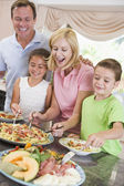 Mother Serving Up Dinner For Family — Stock Photo