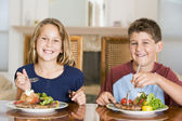 Brother And Sister Eating meal, mealtime Together — Stock Photo