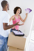 Couple with paint swatches in new home undecided — Stock Photo