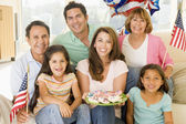 Family in living room on fourth of July with flags and cookies s — Foto Stock
