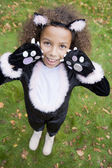 Young girl outdoors in cat costume on Halloween — Photo