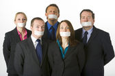 Group Of Business With Their Mouths Taped Shut — Stock Photo