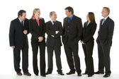 Group Of Business Standing Around Conversing — Stock Photo