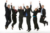 Group Of Business Jumping In The Air — Stockfoto