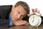 Businessman Leaning On Desk Watching Clock — Stock Photo