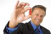 Businessman Holding Two Red Dice — Stockfoto