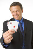 Businessman Holding Four Aces — Stock Photo