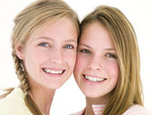 Two girl friends together smiling — Stock Photo