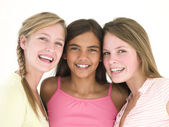 Three girl friends together smiling — Stock Photo