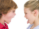 Brother shouting at sister sticking her tongue out — Stock Photo