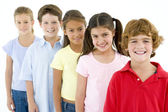Row of five young friends smiling — Stock Photo