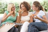 Teenage Girls Sitting On Couch And Eating Pizza Together — Stock Photo