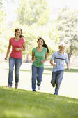 Teenagers Running Through Park — Stock Photo