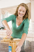 Teenage Girl Making Peanut Butter Sandwich — Stock Photo