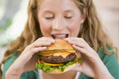 Teenage Girl Eating Burgers — Stock Photo