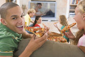 Teenagers Hanging Out In Front Of Television Eating Pizza — Stock Photo