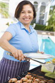 Woman Cooking On A Barbeque — Stock Photo