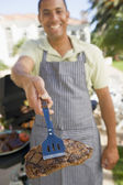 Man Barbequing In A Garden — Stock Photo